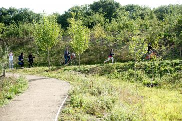 People cycling and walking through the countryside of Eddington